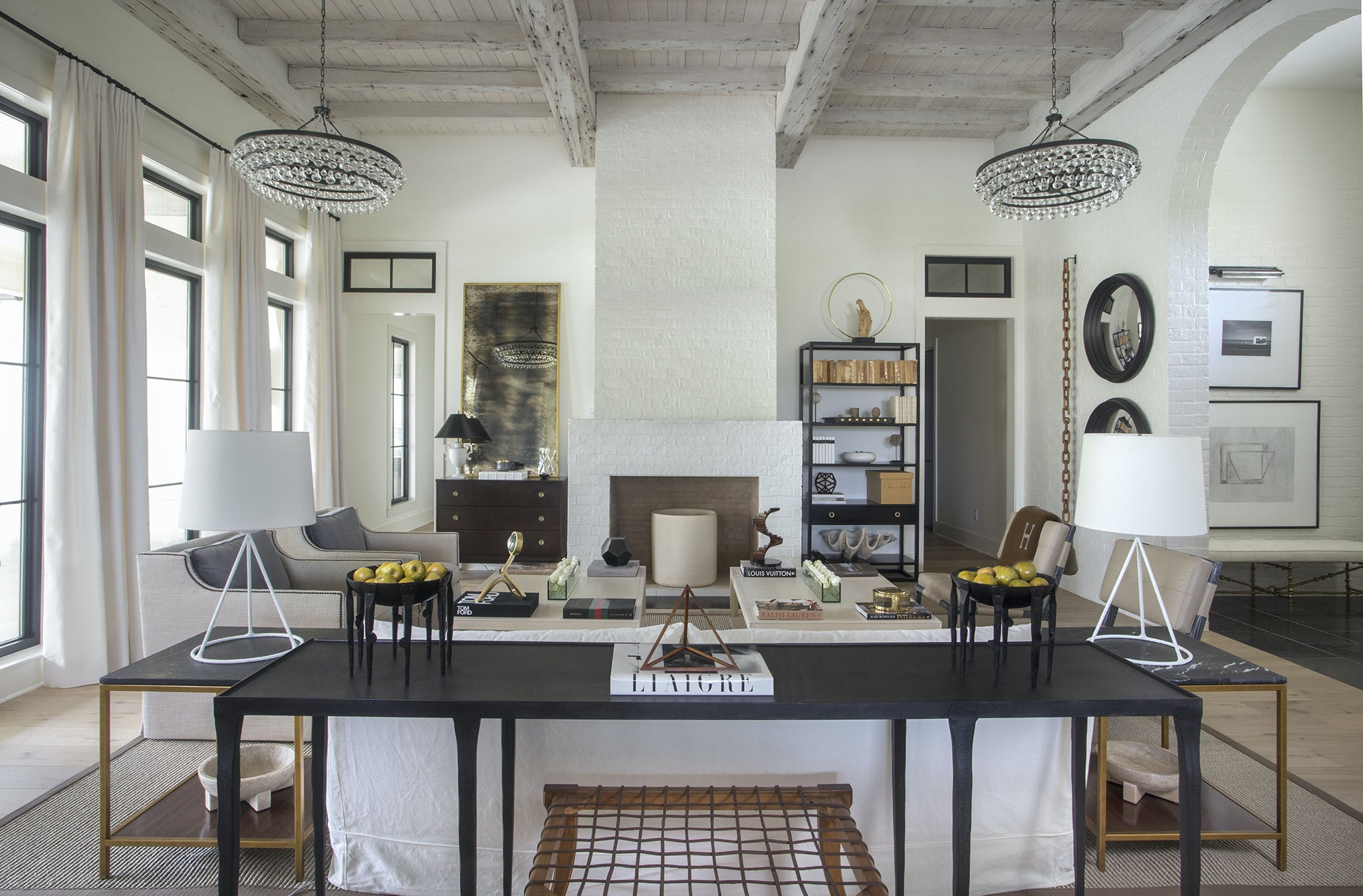 Two Large Chandeliers In The Living Room Flank The Fireplace And Keep The  Sight Line Open Through The Space. Painted Brick, Whitewashed Antique Pine  Beams ...